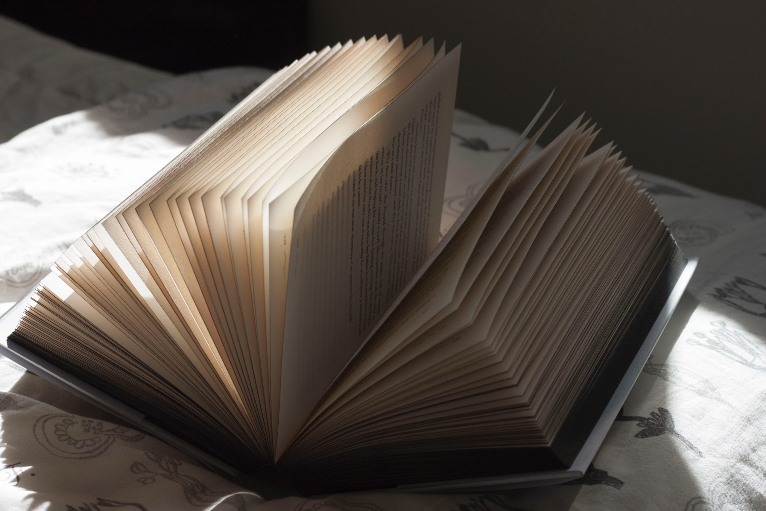 white book on black textile