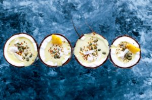 flat-lay photography of four coconut desserts